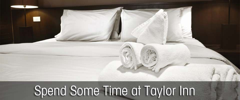 Spend Some Time at Taylor Inn -- white sheets on a bed
